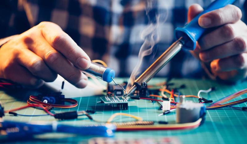 engineer-soldering-a-motherboard